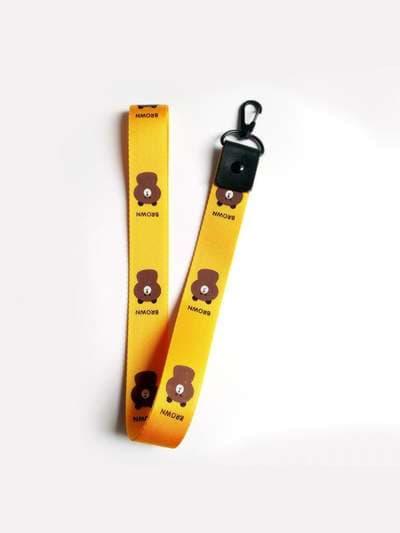 Молодежный брелок на телефон ремешок мишка длинный желтый. Фото товара, вид 1
