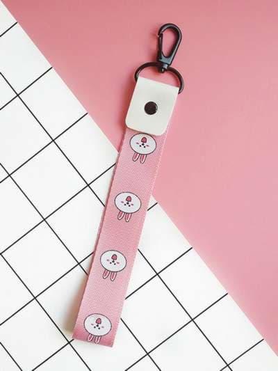 Брендовый брелок на телефон ремешок кролик короткий розовый. Фото товара, вид 1