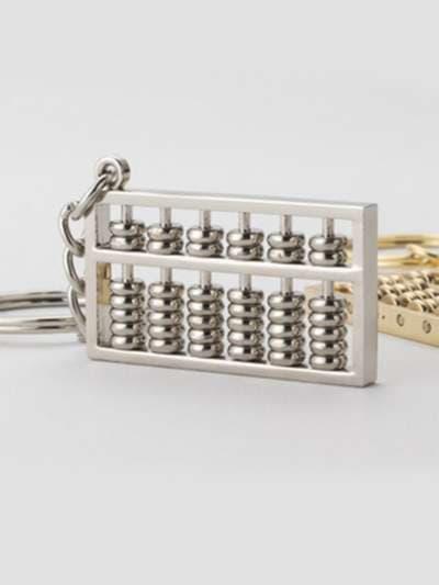 Модный брелок счеты никель. Фото товара, вид 3