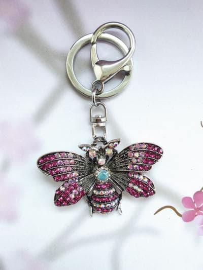 Модный брелок бабочка никель в стразах розовый. Фото товара, вид 1