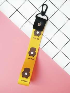 Молодежный брелок на телефон ремешок мишка короткий желтый. Изображение товара, вид 1