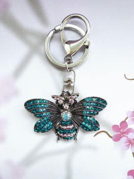 Брендовый брелок бабочка никель в стразах синий. Изображение товара, вид 1