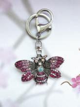 Модный брелок бабочка никель в стразах розовый. Изображение товара, вид 1